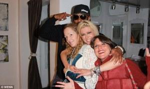 Tony DeNiro, Ashley Paige, Tara Reid, and Annie Preece at the Ashley Paige Bikini Factory.